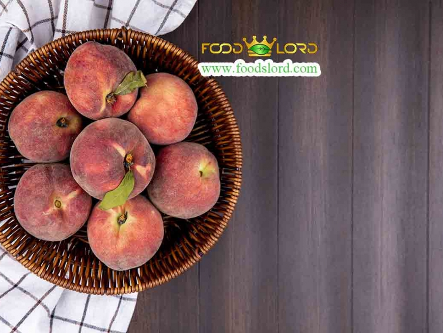 top view of fresh peaches on a bucket on a checked tablecloth on a wooden background with copy space
